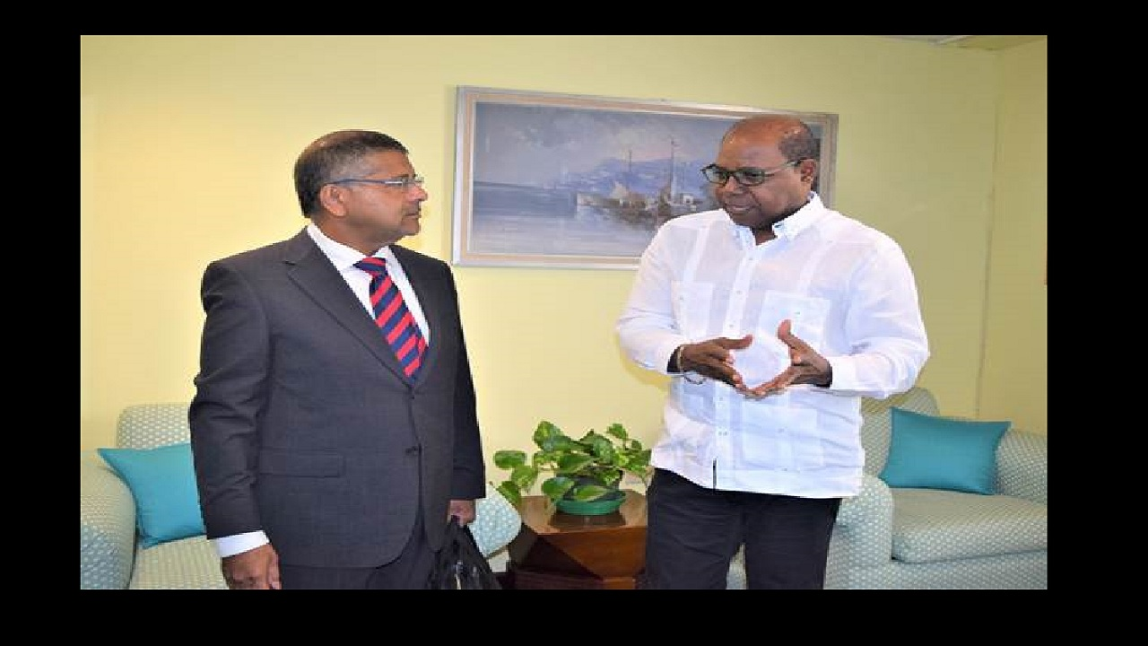Tourism Minister, Edmund Bartlett (right) converses with His Excellency Asif Anwar Ahmad, British High Commissioner to the Jamaica and the Bahamas during a recent courtesy call to the Minister's New Kingston office.