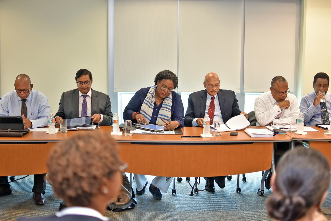 Prime Minister Mia Mottley; Minister of International Business, Ronald Toppin; Minister of Foreign Affairs, Senator Dr. Jerome Walcott; Professor Avinash Persaud and Director of Finance and Economic Affairs, Ian Carrington. (C. Pitt/BGIS)