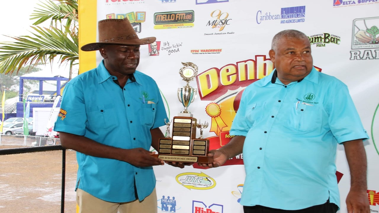 THE OUTGOING AND THE INCOMING: Jamaica Agricultural Society (JAS) President, Norman Grant left) and President-elect, Lenworth Fulton, who is also the President of the winning St Catherine JAS Branch Society, are both distracted during the presentation of the Champion Parish trophy at the Denbigh Agricultural, Industrial and Food Show in Clarendon on August 6.
