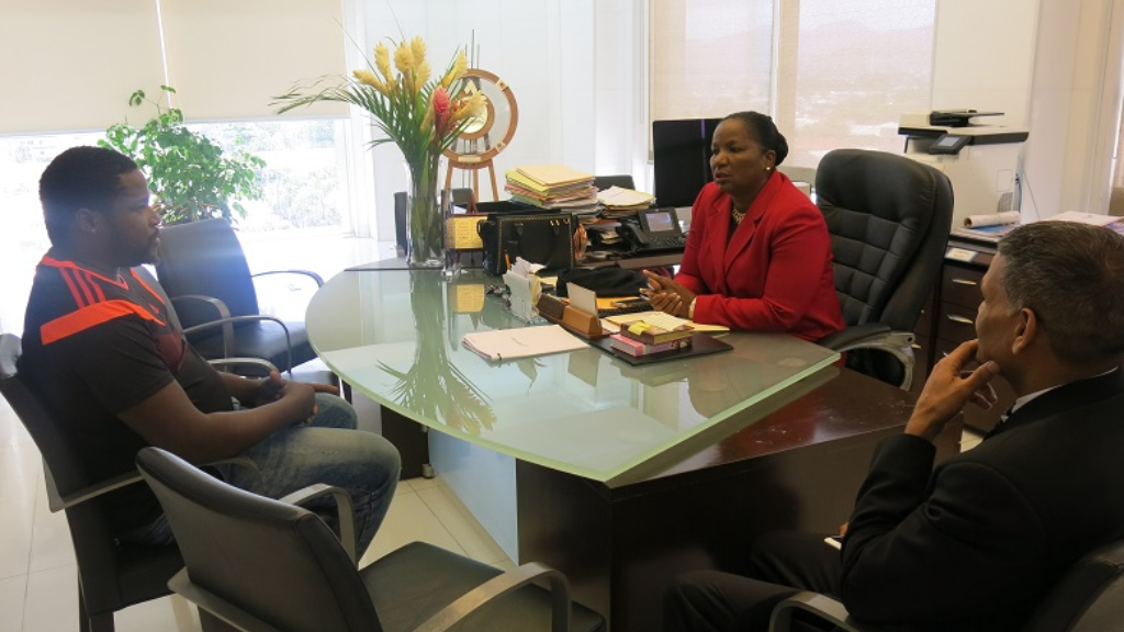 Minister of Social Development and Family Services, Cherrie-Ann Crichlow-Cockburn meets with Wayne Legerton (L) and Deputy Permanent Secretary Vijay Gangapersad