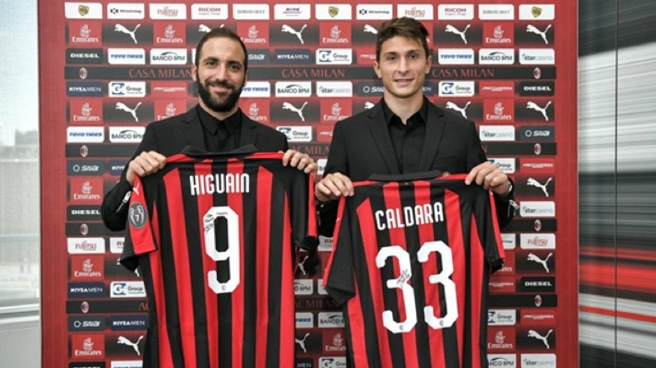 Gonzalo Higuain and Mattia Caldara at their AC Milan presentation.