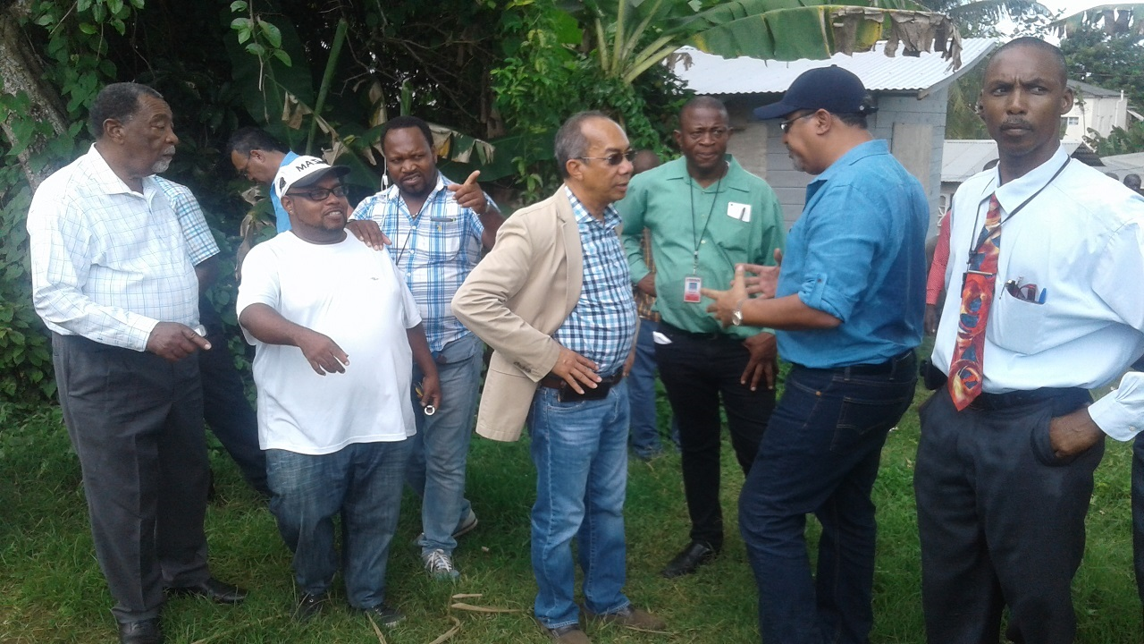 National Security Minister, Dr Horace Chang in discussion with WesternWestmoreland Member of Parliament, Dr Wykeham McNeill during a visit to Grange Hill after gunmen killed seven persons in the community in May.