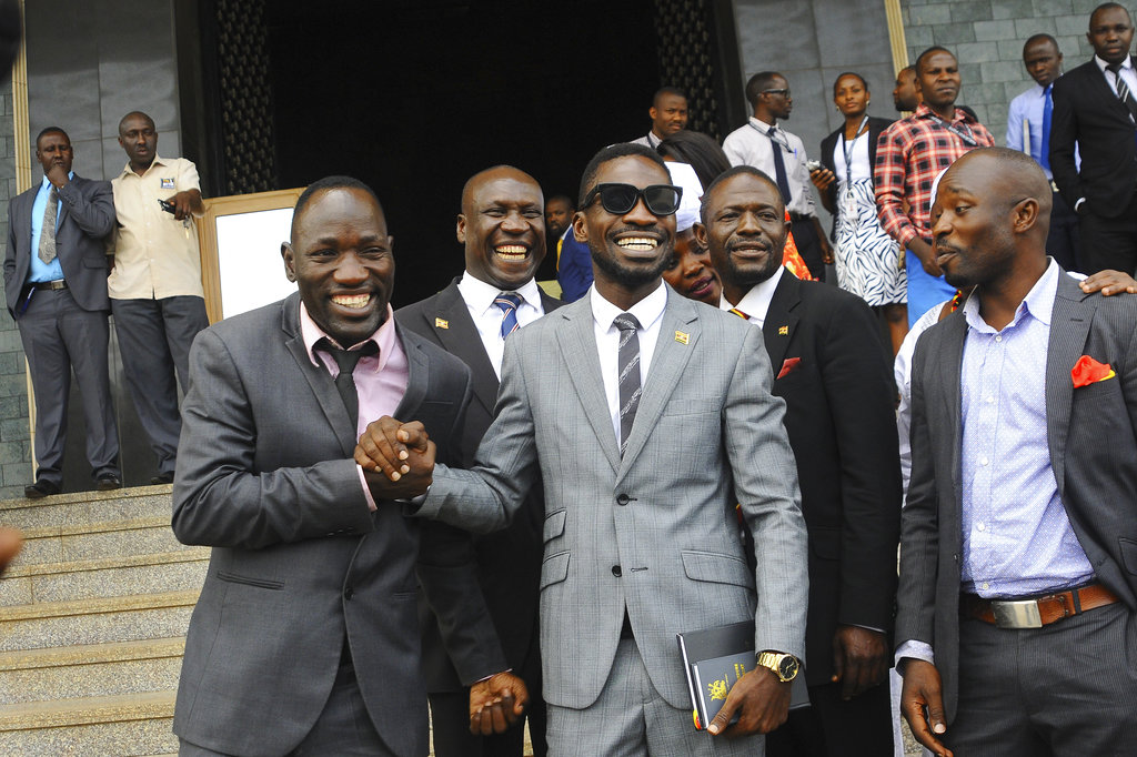 Ugandan pop star Kyagulanyi Ssentamu, centre, leaves shortly after being sworn in as a member of parliament in Kampala, Uganda. (AP Photo/Ronald Kabuubi, File)