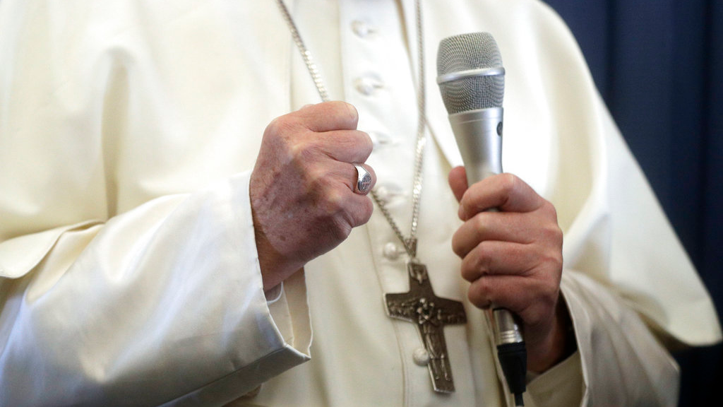 Pope Francis gestures as he answers to a journalist's question during a press conference aboard of the flight to Rome at the end of his two-day visit to Ireland, Sunday, Aug. 26, 2018. (AP Photo/Gregorio Borgia, Pool)
