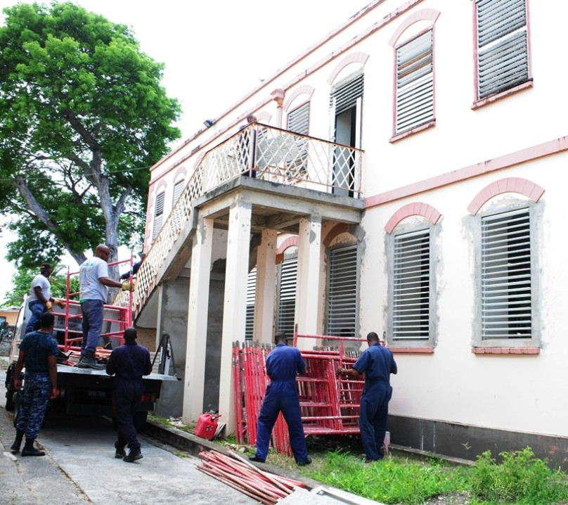 Members of the Barbados Defence Force start the rehabilitation project on the Geriatric Hospital. (B.Hinds/BGIS)
