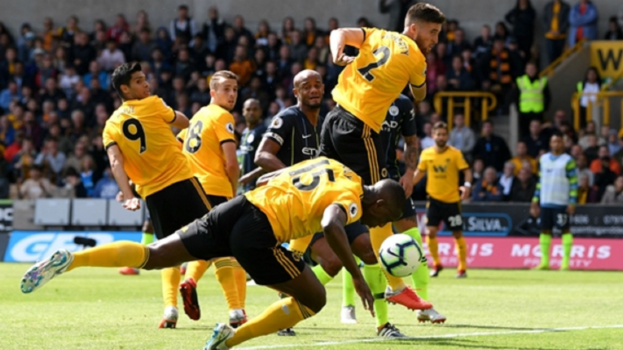 Willy Boly scores Wolves' goal against Manchester City.
