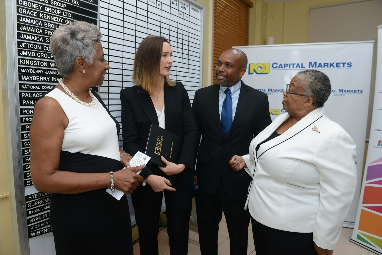 Sandra Glasgow, Board Director, Stanley Motta shares a moment with Melanie Subratie, Chairman, Stanley Motta; Herbert Hall, NCB Capital Markets VP, Investment Banking and Marlene Street Forrest, Managing Director, Jamaica Stock Exchange (JSE) after the property investment giant listed on the main market of the JSE recently.