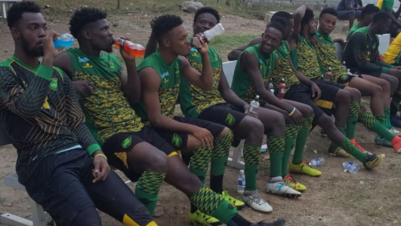 Members of Jamaica's Reggae Boyz squad takes a break during a training session at the JFF/Captain Horace Burrell Centre of Excellence in Kingston on Saturday. (PHOTO: Concacaf).