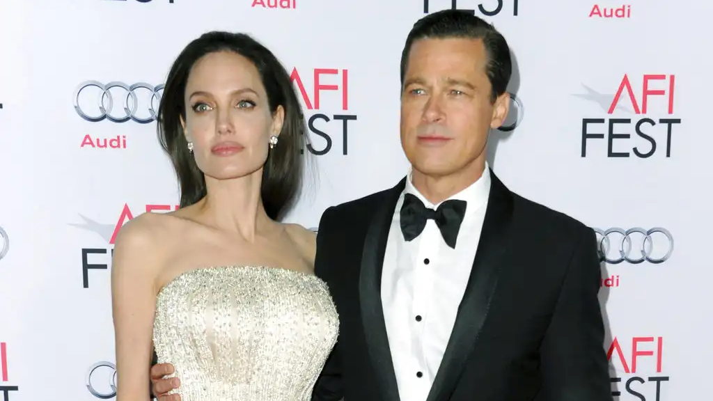 "FILE - In this Nov. 5, 2015 file photo, Angelina Jolie, left, and Brad Pitt arrive at the 2015 AFI Fest opening night premiere of ""By The Sea"" in Los Angeles. (Photo by Richard Shotwell/Invision/AP, File)"