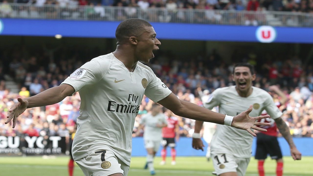 PSG's Kylian Mbappe celebrates after scoring the second goal for his team during their League One football match against Guingampat Roudourou stadium in Guingamp, western France, Saturday, Aug. 18, 2018.