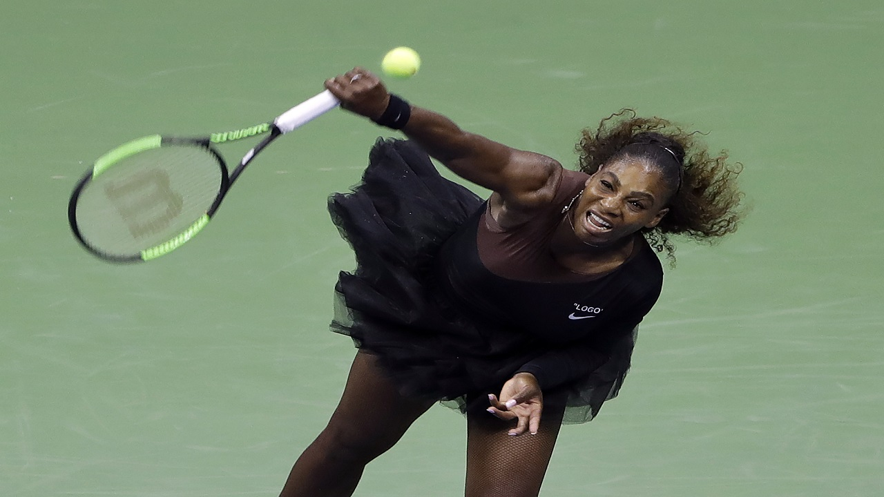 Serena Williams, of the United States, serves to Magda Linette, of Poland, during the first round of the U.S. Open tennis tournament, Monday, Aug. 27, 2018, in New York.