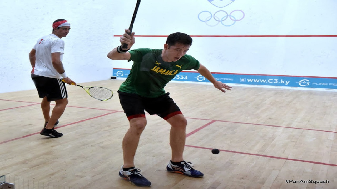 Reigning Jamaican and Caribbean Squash Champion, Chris Binnie (right) in action in the finals of the 2018 Pan American Squash Championships against Diego Elias of Peru (left) on Wednesday night in the Cayman Islands.