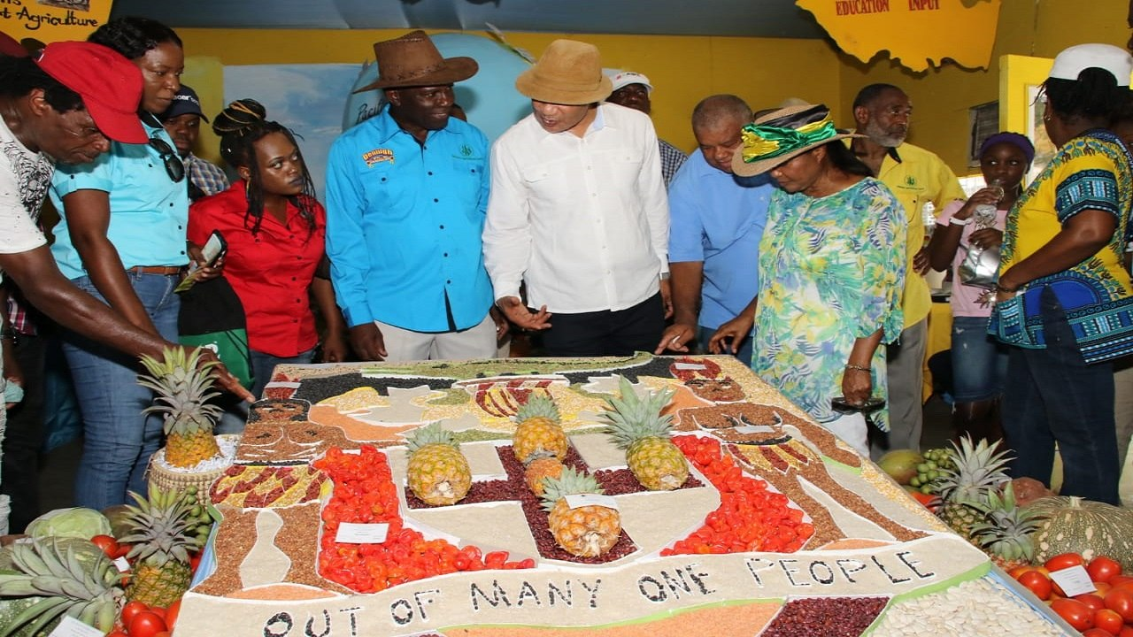 President of the Jamaica Agricultural Society, Norman Grant (centre) with Governor General, Sir Patrick Allen and his wife, Lady Allen, and other guests at Denbigh on Sunday. (PHOTOS: Llewellyn Wynter)
