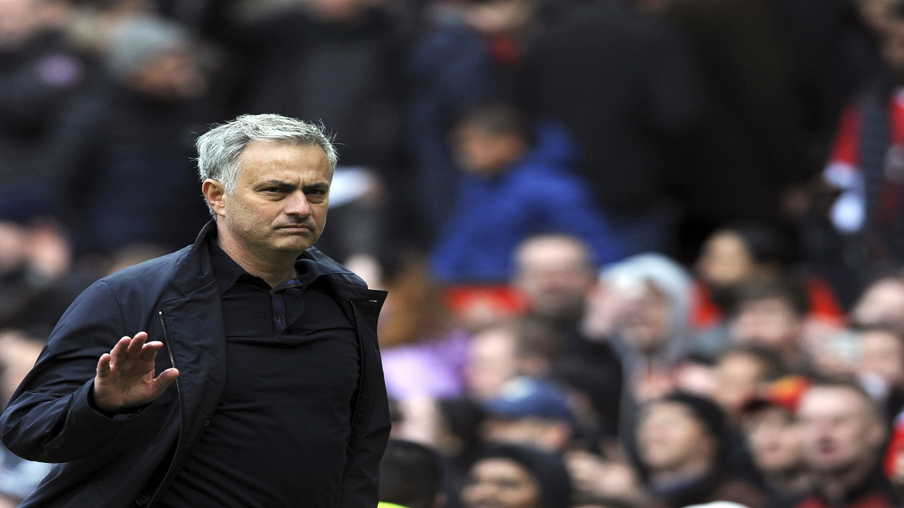In this file photo dated Sunday, April 29, 2018, Manchester United manager Jose Mourinho walks on the pitch at the end of the English Premier League football match against Arsenal at the Old Trafford stadium in Manchester, England.