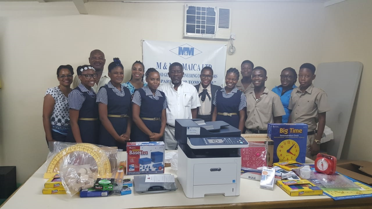: Don Mullings (centre), Managing Director, M&M Jamaica along with teachers and students from St. Elizabeth Technical High School (STETHS) and members of the STETHS Past Students Association. The group recently gathered at M&M Jamaica for the handing over of equipment and supplies for the Mathematics Department of the institution.