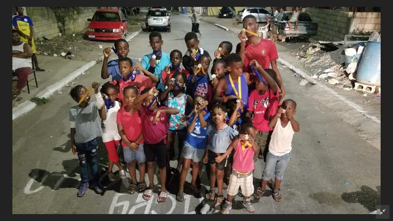 A group of Maverley children pose with the medals they earned at Sports Day for Peace.