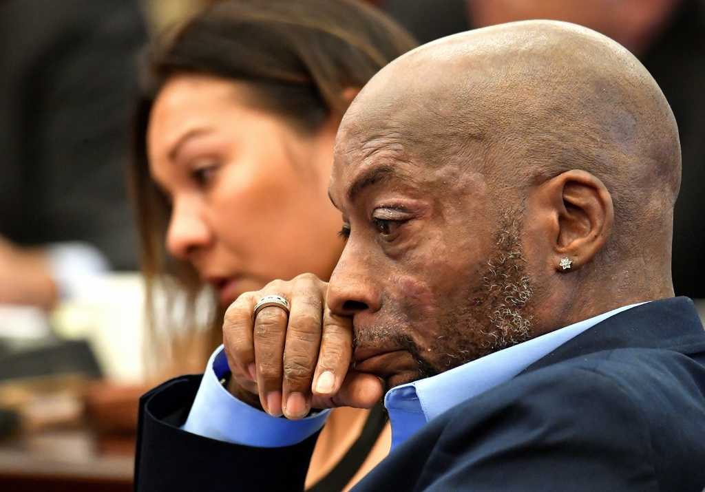 In this July 9, 2018, file photo, Plaintiff Dewayne Johnson, right, reacts while attorney Brent Wisner, not seen, speaks about his condition during the Monsanto trial in San Francisco.