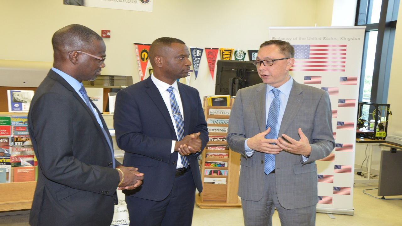 (l-r) Denzil Thorpe Permanent Secretary, Ministry of Culture, Gender Entertainment and Sport; Asburn Pinnock, President, Mico University College and Eric Khant Chargé d'Affaires, U.S. Embassy share in a discussion following the official handover ceremony.