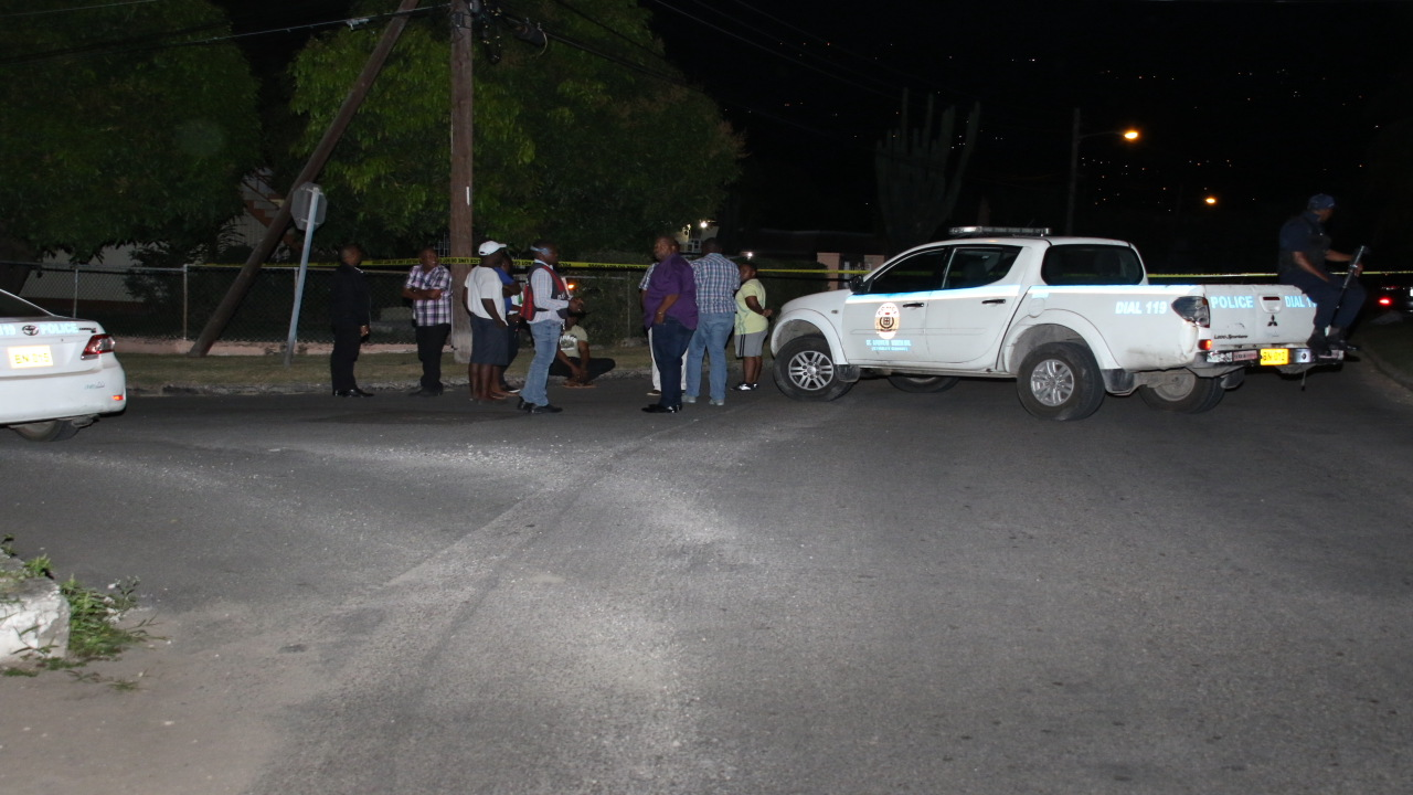 Police and residents at a crime scene in Havendale earlier this year.
