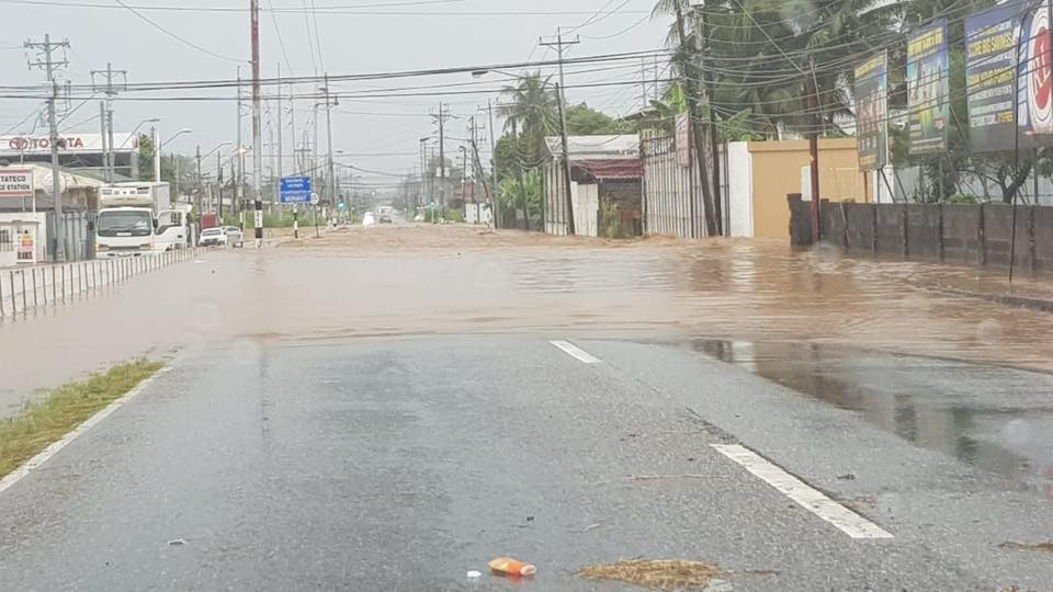 Photo: Flash flooding near Maritime Roundabout, Barataria, on August 13, 2018.