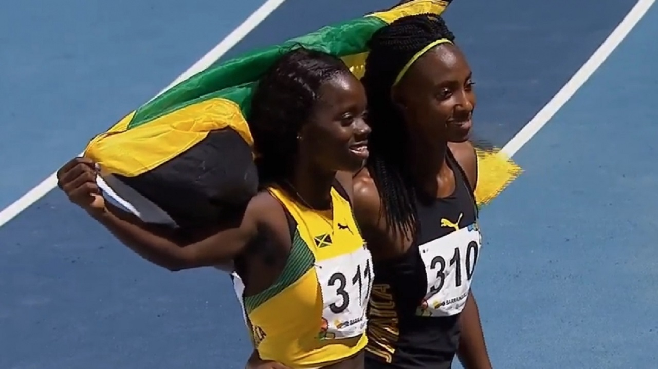 Jamaica's Tiffany James (left) and Derri-Ann Hill celebrate winning gold and bronze respectively in the women's 400m final at the 23rd CAC Games in Barranquilla, Colombia on Wednesday night.