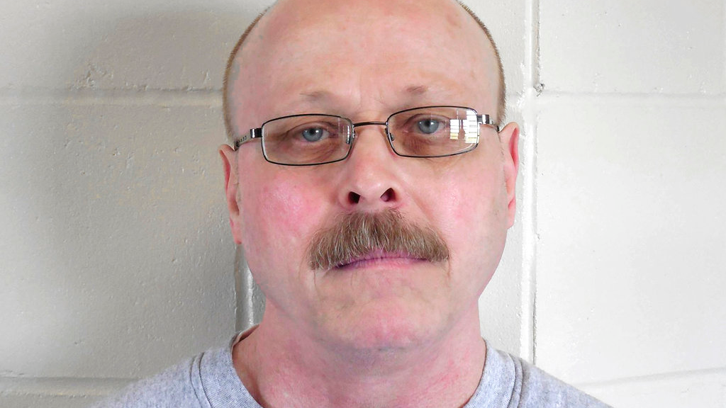 FILE - This file photo provided by the Nebraska Department of Correctional Services shows death-row inmate Carey Dean Moore. Nebraska prison officials are preparing to execute Moore on Tuesday, Aug. 14, 2018, for the 1979 murders of two Omaha cab drivers. The execution comes three years after Nebraska lawmakers voted to abolish capital punishment, but did an about-face driven largely by the state's Republican governor. (Nebraska Department of Correctional Services via AP, File)