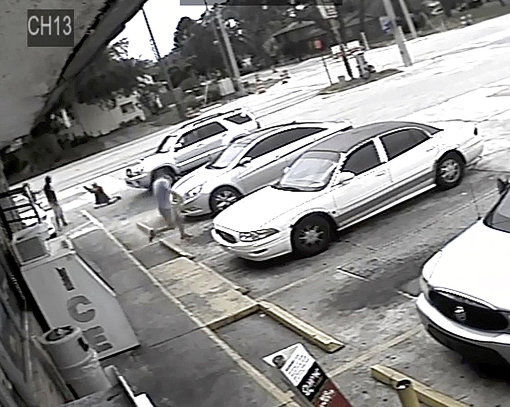 FILE - In this July 19, 2018 file frame from surveillance video released by the Pinellas County Sheriff's Office, Markeis McGlockton, far left, is shot by Michael Drejka during an altercation in the parking lot of a convenience store in Clearwater, Fla.  (Pinellas County Sheriff's Office via AP, File)