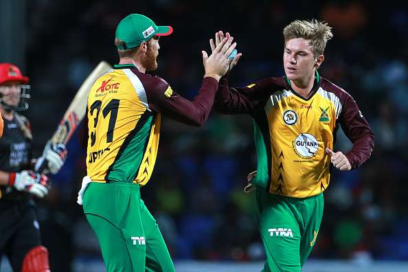 Adam Zampa (right) represented the Guyana Amazon Warriors in 2016
