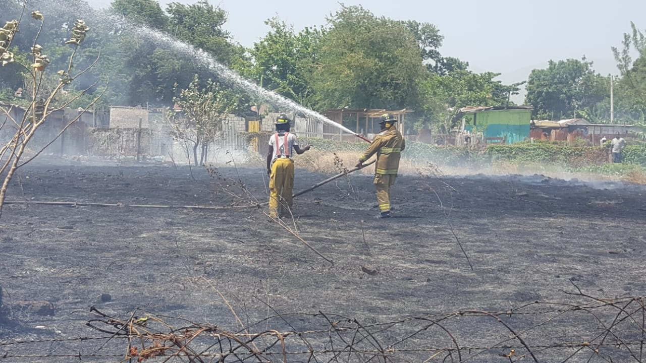 Firefighters battle the blaze at No Man's Land. (PHOTO: Marlon Reid)