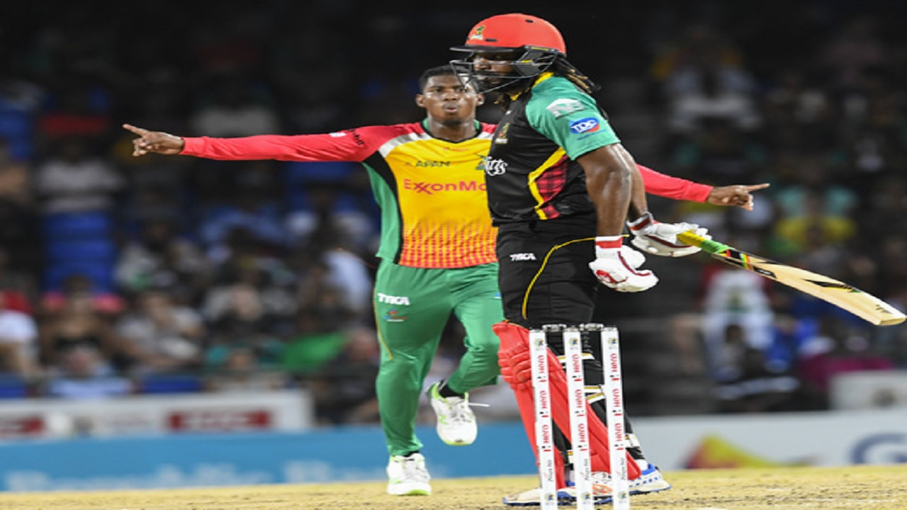 Chris Gayle (right) of St Kitts and Nevis Patriots dismissed by Keemo Paul of Guyana Amazon Warriors during match 19 of the Hero Caribbean Premier League at the Warner Park Sporting Complex on August 25, 2018 in Basseterre, St Kitts. (PHOTO: CPL via Getty Images).