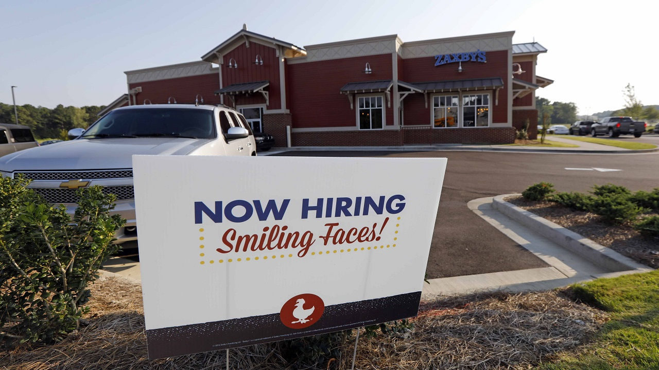 This photo shows a help wanted sign at a new Zaxby's restaurant in Madison, Mississippi. (AP Photo)