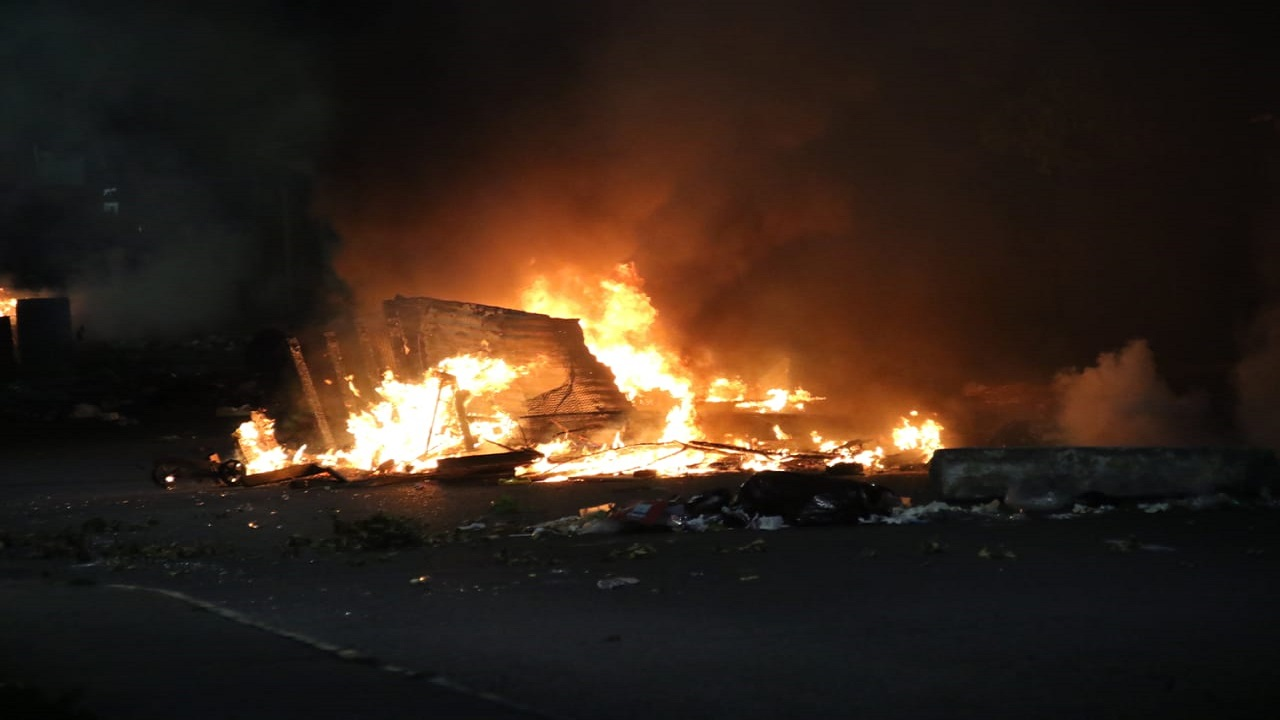 Debris on fire during a protest in Swallowfield on Tuesday night.