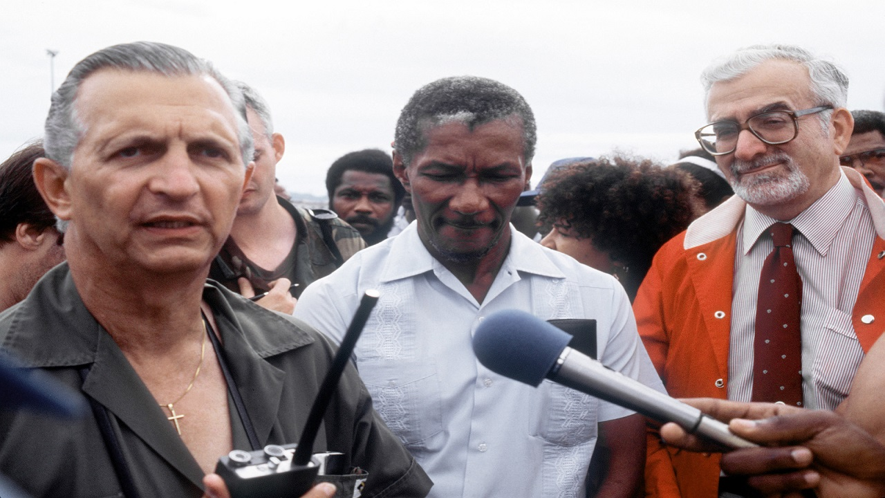 Then Prime Minister Edward Seaga speaks to reporters after accepting the first shipment of US-provided supplies, in the aftermath of Hurricane Gilbert's passage across Jamaica in 1988. (PHOTO: PICRYL)
