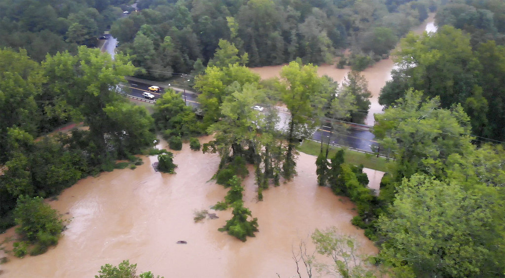 The floodwaters of McAlpine Creek along Randolph Road in Charlotte, N.C., are seen on Sunday, Sept. 16, 2018. Tropical Storm Florence forced McAlpine Creek from its bed, flooding the popular greenway for walkers and bicyclists. (Jeff Siner/The Charlotte Observer via AP)