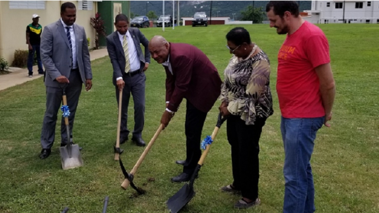 JFF President Michael Ricketts (3rd left) and Sports Minister Olivia Grange (4th left) break ground for the construction of a new synthetic pitch at the Horace Burrell Centre of Excellence in Kingston on Tuesday.