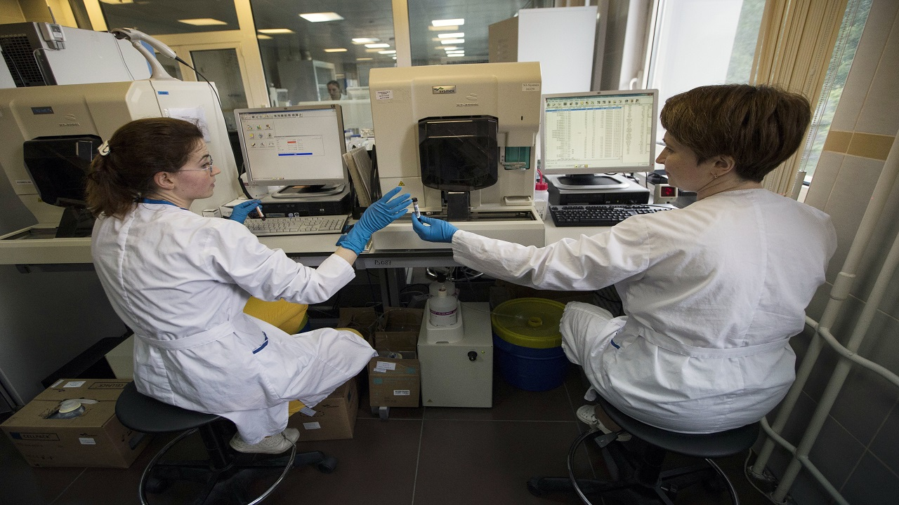 In this May 24, 2016 file photo employees work in Russia's national drug-testing laboratory in Moscow.