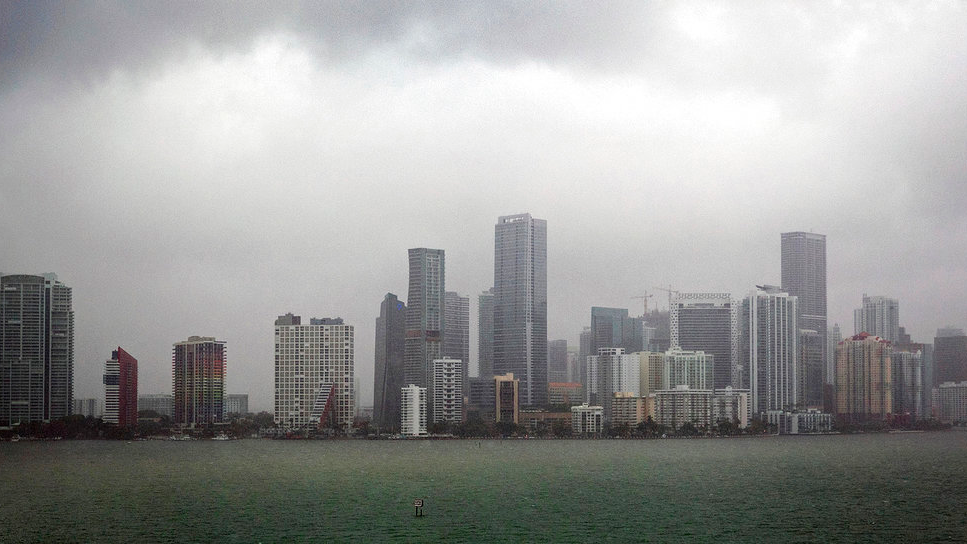Rain fall upon the Miami skyline this Labor Day weekend on Monday, Sept. 3, 2018. Tropical Storm Gordon lashed South Florida with heavy rains and high winds on Monday, forcing holiday beachgoers to drier ground. Weather forecasters said the storm could strengthen to near-hurricane force by the time it hits the central U.S. Gulf Coast. (C.M. Guerrero/Miami Herald via AP)