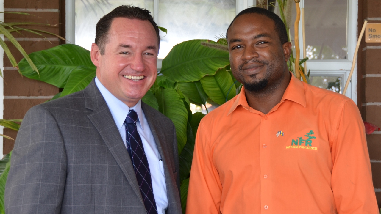 "Corey Lane (right) poses with U.S. Deputy Chief of Mission to Barbados, the Eastern Caribbean, and the OECS, Joaquin Monserrate before he departed on his IVLP program on ""Non-governmental Organization (NGO) Management."""