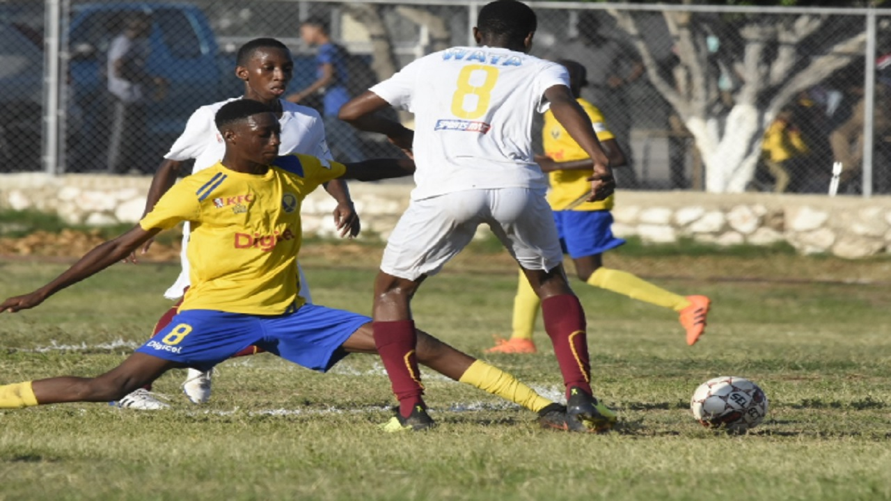 Deshawn Bernard (right) of Wolmer's Boys moves away from Waterford High's Akeem Chaplin during their ISSA/Digicel Manning Cup football match at Heroes Circle on Tuesday, September 11, 2018.  Both school return to action on match day four on Friday, September 14. (PHOTO: Marlon Reid).