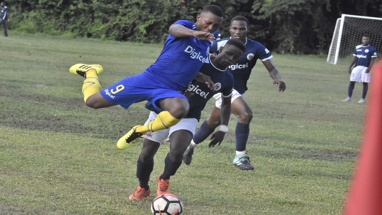 Action from the ISSA/Digicel Manning Cup Group F top-of-the-table fixture between five-time defending champions Jamaica College (JC) and Hydel High at Caymanas on Saturday, September 29. JC won 3-2. (PHOTOS: MARLON REID).