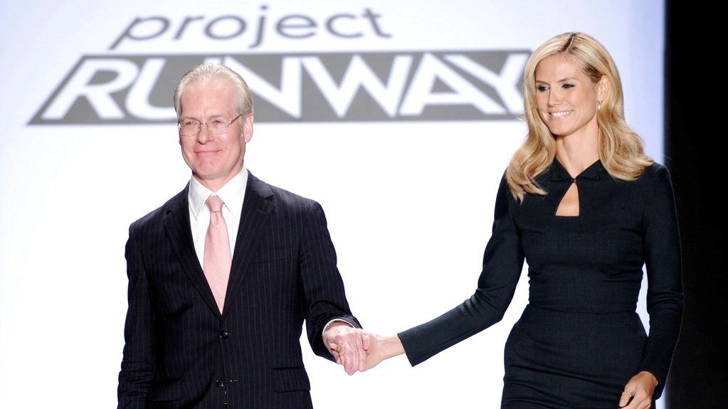 In this Sept. 12, 2008 file photo, Project Runway's Tim Gunn walks with Heidi Klum on the runway during Fashion Week in New York. (AP Photo/Richard Drew, file)