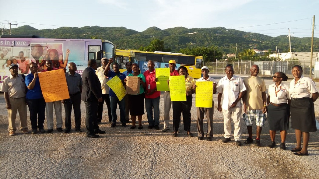 Montego Bay Metro bus service workers on strike at their office at Bogue in Montego Bay, St James.