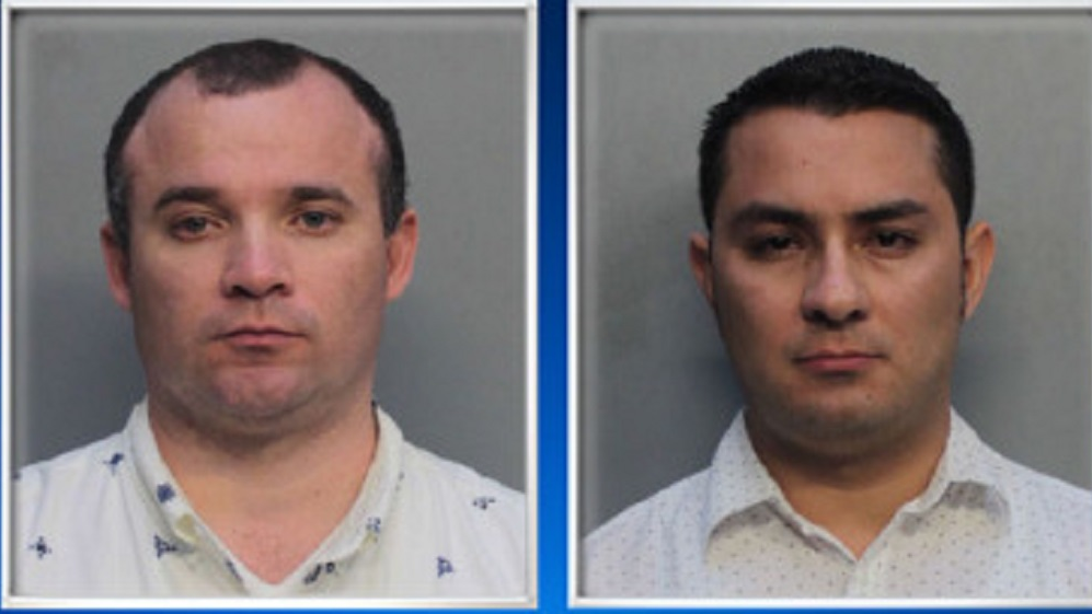 Photo L-R: Diego Berrio and Edwin Giraldo Cortez were arrested for lewd and lascivious behaviour after they were caught performing a sexual act  in a car parked on a Miami street earlier this week.