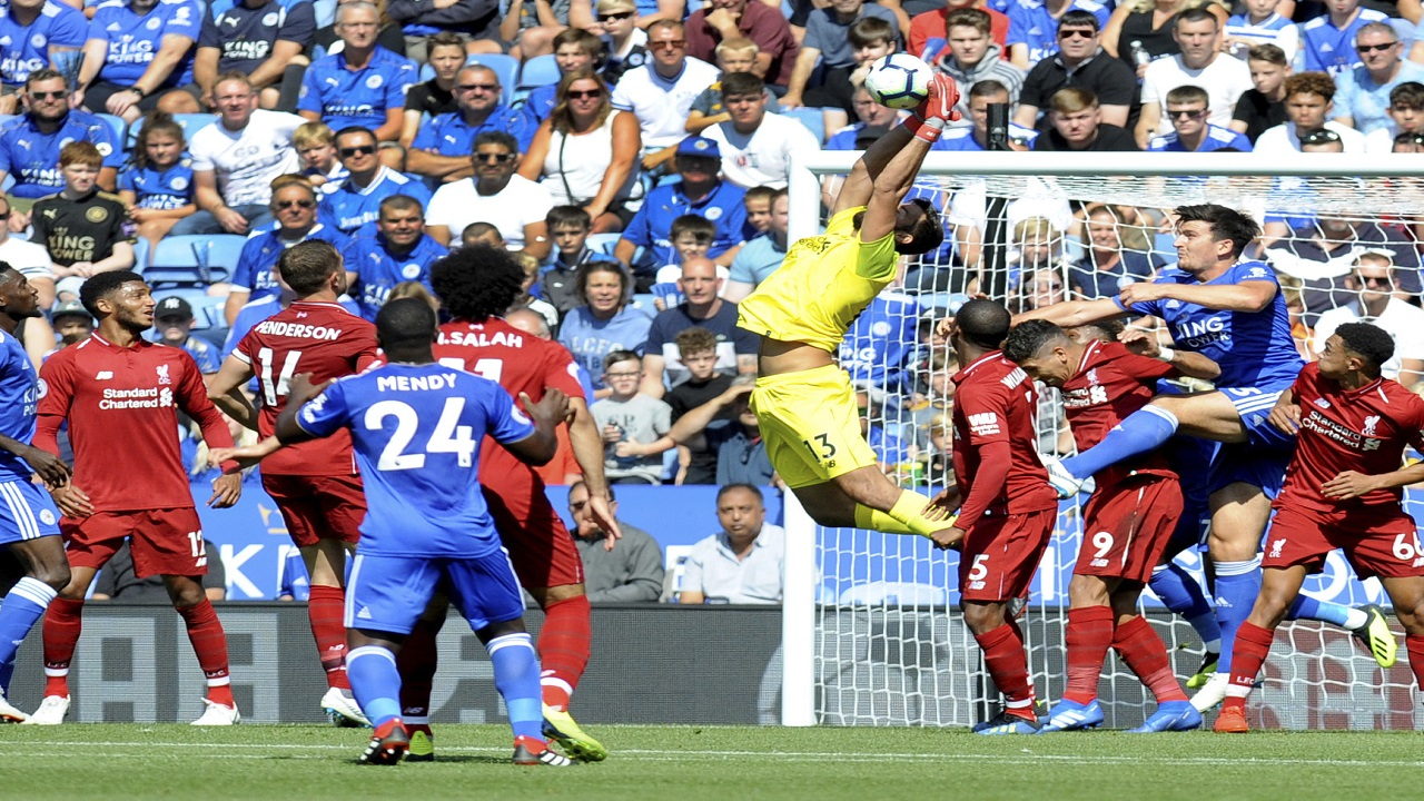 Liverpool's goalkeeper Alisson, centre, makes a save during the English Premier League football match against Leicester City at the King Power Stadium in Leicester, England, Saturday, Sept. 1, 2018.