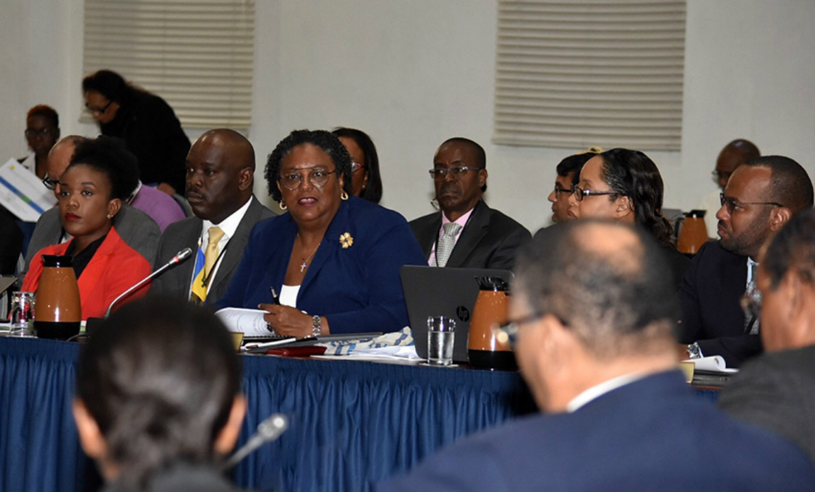Prime Minister Mia Mottley speaking during today's Sixth Special Meeting of the Council for Finance and Planning (COFAP) at the Lloyd Erskine Sandiford Centre while members of the Barbados delegation listen attentively. (C.Pitt/BGIS)