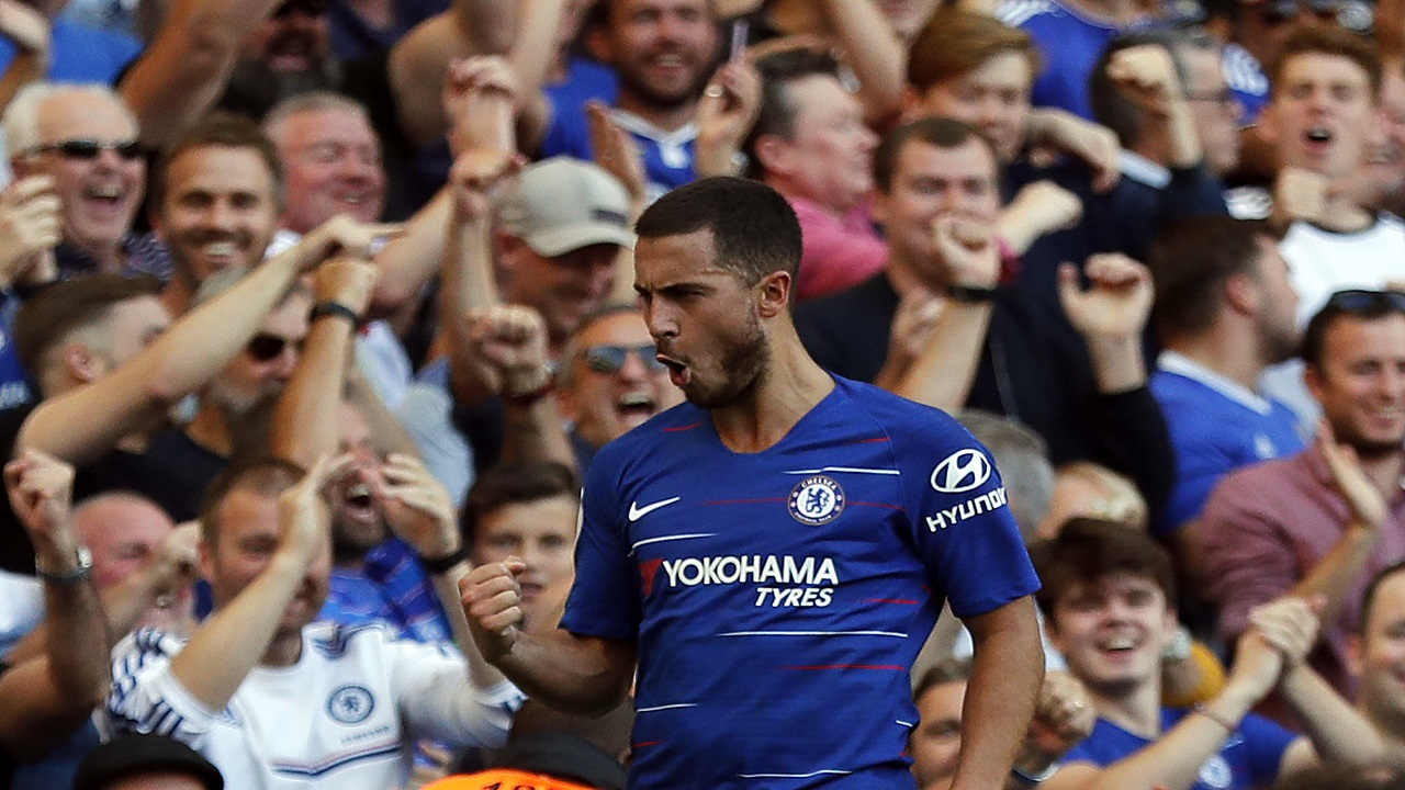 Chelsea's Eden Hazard celebrates after scoring his side's second goal during the English Premier League football match against Bournemouth at Stamford Bridge stadium in London, Saturday, Sept. 1, 2018