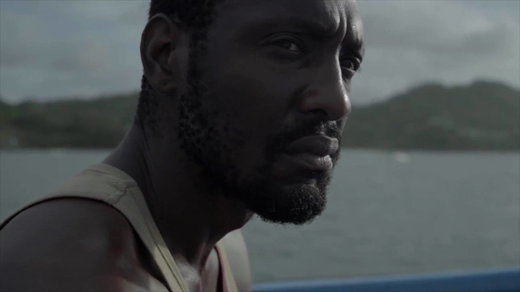 Paul Pryce stars as Joseph Chike in The Deliverer, a short film he wrote and produced.