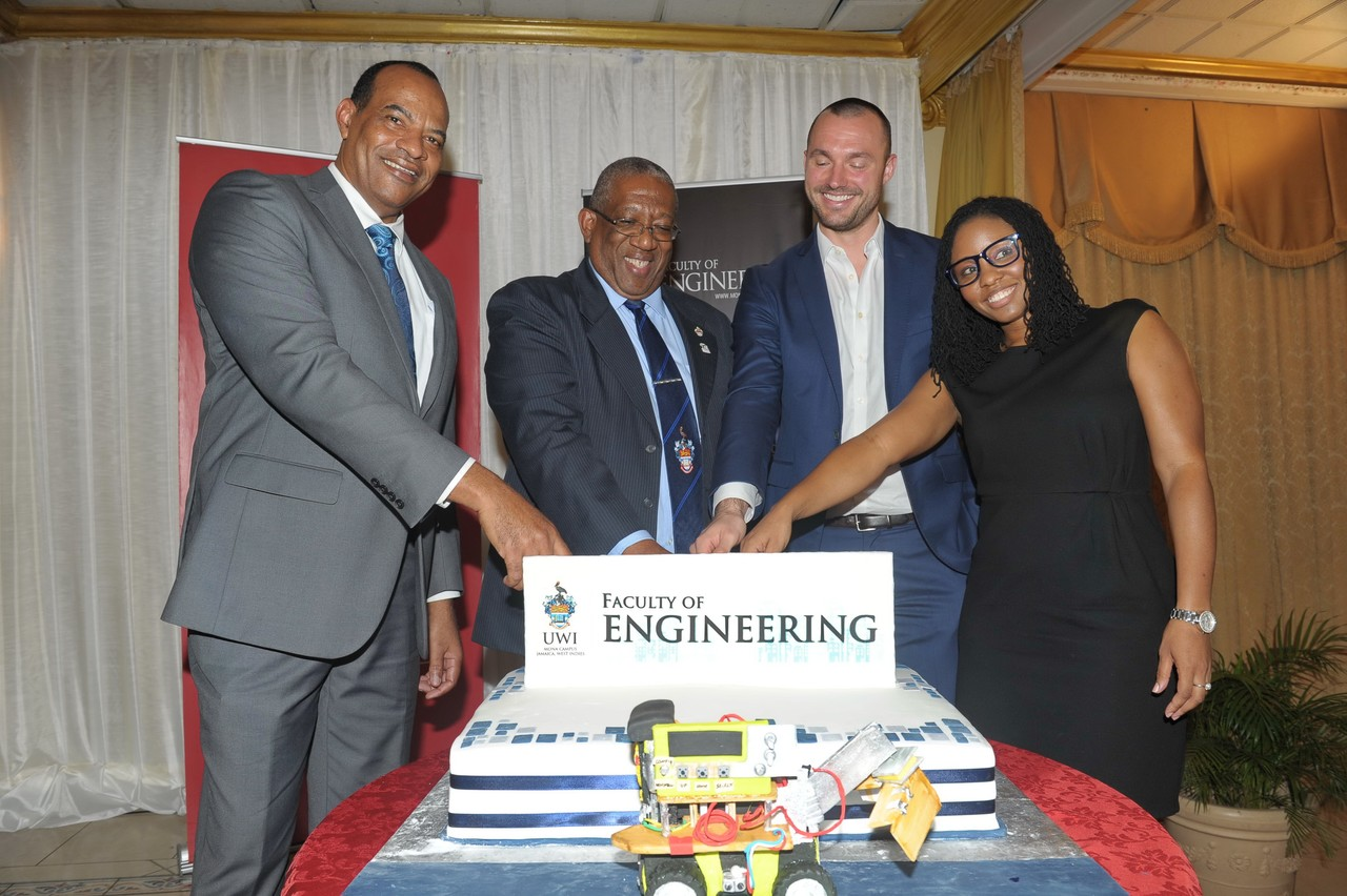 Dr. Paul Aiken, newly appointed Dean of the Faculty of Engineering, Pro Vice-Chancellor and Principal of the Mona Campus, Professor Dale Webber; managing director of New Fortress Energy, Jake Suski and Senior Administrative Assistant, Cherri-Ann Scarlett cuts the celebratory cake at the official Launch of the Faculty of Engineering.