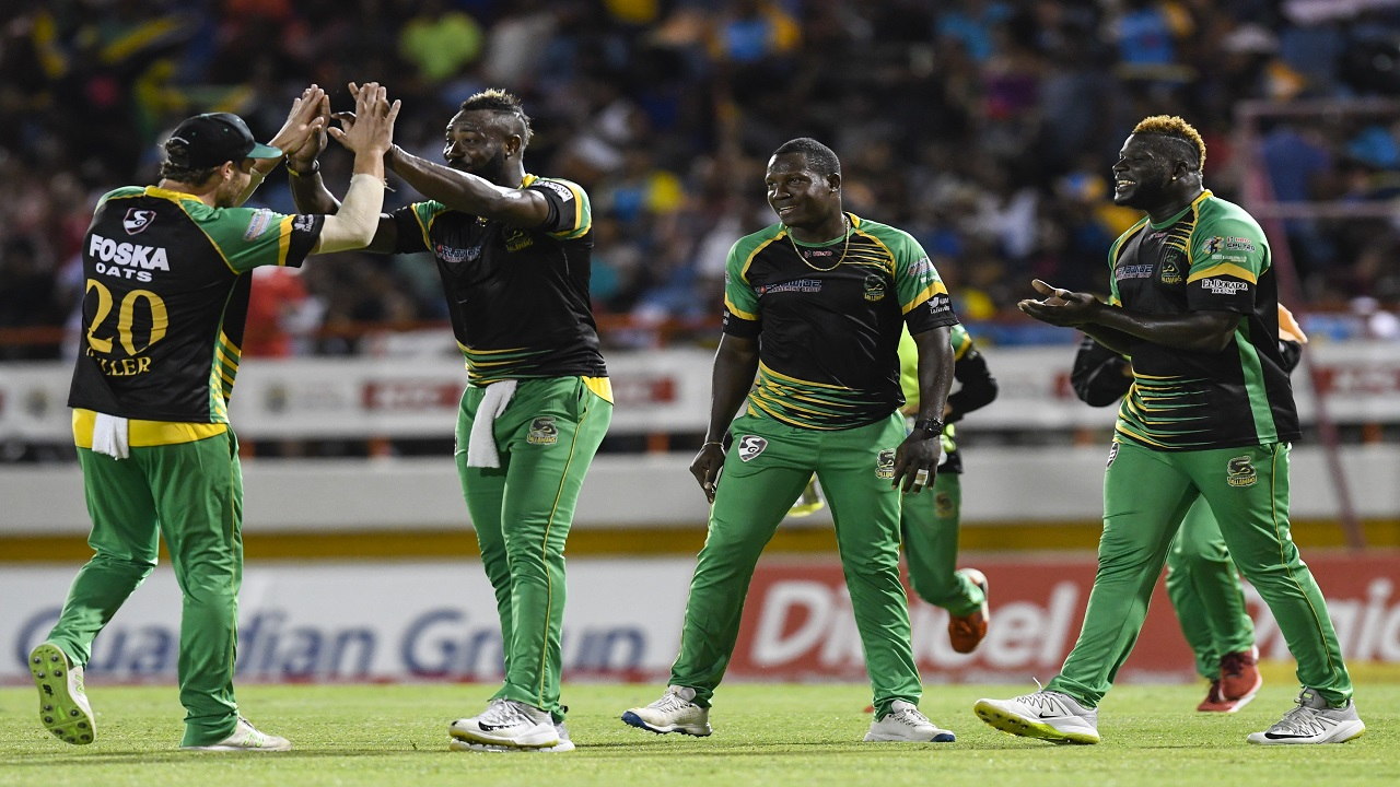 David Miller (left), Andre Russell (2nd left), Rovman Powell (2nd right) and Kennar Lewis (right) of Jamaica Tallawahs celebrate during match 17 of the Hero Caribbean Premier League against St Lucia Stars at the Darren Sammy Cricket Ground on Saturday, August 25, 2018. (Photo: CPL via Getty Images.)