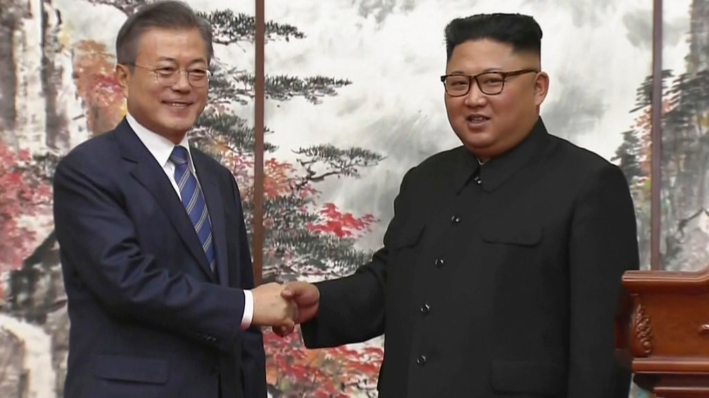 In this image made from video provided by Korea Broadcasting System (KBS), North Korean leader Kim Jong Un, right, and South Korean President Moon Jae-in shake hands at the end of their joint press conference in Pyongyang, North Korea Wednesday, Sept. 19, 2018. (Korea Broadcasting System via AP)